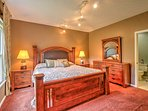The beautifully decorated master bedroom downstairs has a king-sized bed and matching furniture pieces.