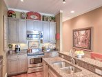 The kitchen is equipped with stainless steel appliances and granite countertops.