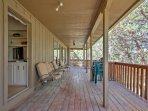 This 5-bedroom, 3-bathroom cabin-style home boasts a large back deck with mountain views.