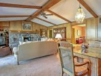 The large living room features cathedral ceilings and exposed wooden beams.