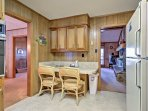 Enjoy your morning coffee at the breakfast table in the kitchen.