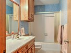 Two different bathrooms provide tub/shower combos.