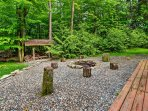 Relish in the natural beauty that surrounds the property outside next to the fire pit.