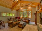 Natural sunlight in the living room with couch seating for eight
