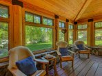 Indoor deck space with wooden furniture, and bright windows