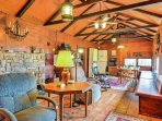 This cottage features vaulted ceilings and beautiful wood beams that create a rustic feel.
