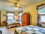 This bedroom features a queen and full-sized bed with cozy quilting.
