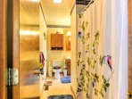 This full bathroom features a shower/tub combo for guests to use throughout their stay.