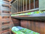 The middle bunk features a safety gate for younger children and toddlers.