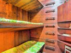 Climb up the ladder to access the middle and top bunk.