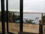 The view of the River Forth all the way to the sea through the Cabin's bi-fold doors