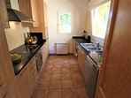 Modern fitted ,fully equipped separate kitchen.