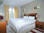 Our spacious master bedroom has anew super-king size bed and satellite  television