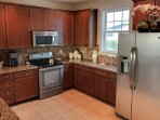 Large well equipped kitchen with stainless steel appliances every utensil you will possibly need.