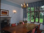 Fabulous Dining Room with large log burner and overlooking the garden.