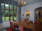 Dining Room with an enormous dining table that can seat 14 people easily. Great for socialising.