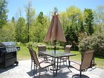 Patio overlooking backyard, relax and watch the kids play