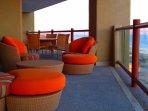 Comfy balcony to enjoy both sunrises and sunsets