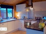 There is a well equipped kitchen and dining area with dishwasher, utility room washer and dryer