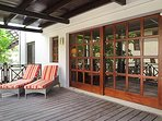 BonitVistaVillas shows more photo's. Spaceful porch with relaxingchairs and 6-p.dining table.