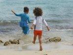 Kids having fun in sea & sand.
