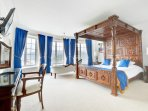Master bedroom with Super king size, mahogany Four Poster bed and panoramic seaviews