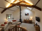 Vaulted ceiling in the lounge with original beams.