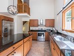Kitchen with Center Prep Island and Stainless Appliances
