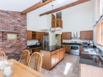 Kitchen with Center Prep Island and Stainless Appliances , Dining Area
