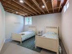Over flow sleep room lower level not part of 3 bedrooms listed