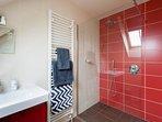 2nd bedroom en-suite bathroom with walk-in shower, basin and toilet