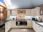 Well equipped kitchen. Fridge/freezer, dish washer, wine fridge etc.