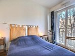 Bedroom 3:is furnished with : double bed, bedside table, desk, armchair, A/C, hard wooden floor.