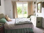 The charming green bedroom. This room also has a small sofa bed suitable for 1 person or 2 children.