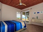 3rd Bedroom with queen size bed and view of the sea from your bed.