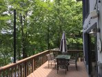 View of deck on lake side of home.
