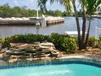 Private, tropical waterfront backyard with heated pool