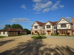 Oak Lodge (left) lies next to its owner's stunning home in beautiful open countryside