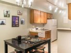 The kitchen is cozy but functional. The appliances are new and in good condition.