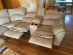 Living room features sectional that is italian leather and three recliners
