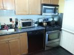 Kitchen with dish washer, oven, gas range, refrigerator and microwave