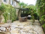 Lovely flagstone terrace with shaded area for al fresco dining!