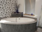 Master ensuite/ family bath with jacuzzi. and large walk in double shower.