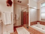 Jacuzzi tub, jumbo dual headed shower, flat screen TV in bathroom, heated floors!