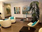 A modern designed Wave Condo Lobby with elevator & restroom.