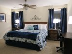 Second King size Bedroom located on Main level. Alarm Clock, TV, DVD Player, Desk/Vanity.