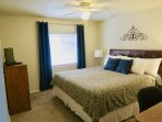 Bedroom #5 is located on lower level and features King bed, TV, DVD player, Desk/Vanity, Alarm Clock