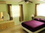 Queen size bed with walk in closet, Jacuzzi, and garden view