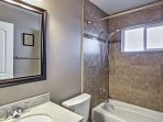 The recently remodeled full bathroom has a shower/tub combo.