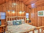 The bedroom has a king-sized bed on a custom-made log frame.